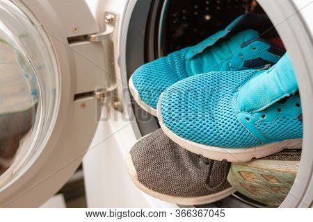 Pair Of Sneakers In Washing Machine, Closeup