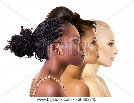 Multi-ethnic beauty concept. Different ethnicity women - African, Asian, Caucasian. Three beautiful ladies of different races. Pretty female faces in profile. Diversity, international models