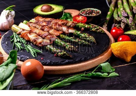 Cooking Banner. Background With Grilled Green Asparagus Wrapped With Bacon. Food Recipe