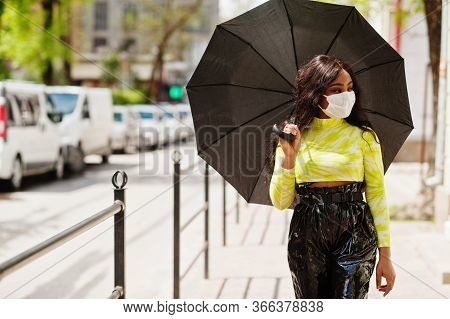 African American Woman Posing With Facial Mask To Protect From Infections From Bacteria, Viruses And