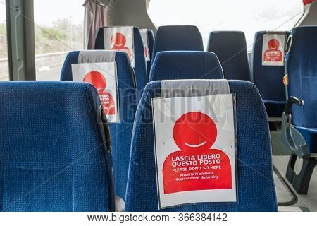 COVID-19 Public transport bus during the coronavirus pandemic. Empty seats in the bus with new social distancing protect rules during pandemic of coronavirus in Italy