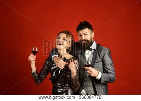 Lady And Gentleman Celebrating With Merlot Wine. Couple In Love
