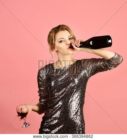 Woman With Serious Face Drinks Expensive Cabernet Or Merlot