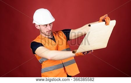 Engineer, Architect, Builder On Strict Face Holds Old Blueprint In Hands, Supervises Construction Si