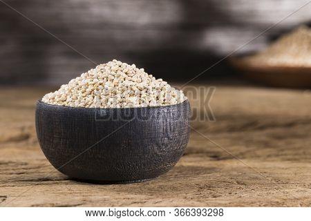 Wooden Bowl With Quinoa Grains On The Table, Chenopodium Quinoa