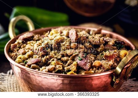 Beans With Pork, Called Tropeiro Beans, Typical Brazilian Food, State Of Minas Gerais. Copper Pot On