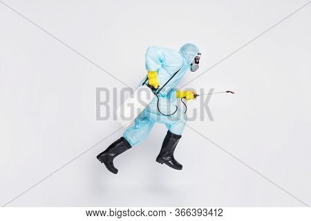 Full Body Profile Side Photo Man Jump Run Hurry Disinfect Covid Spread House Wear White Hazmat Suit