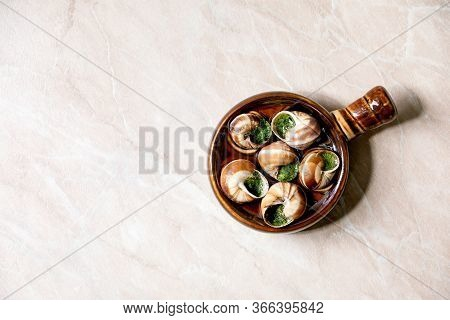 Escargots De Bourgogne - Snails With Herbs Butter, Gourmet Dish, In Traditional Ceramic Pan Over Pin