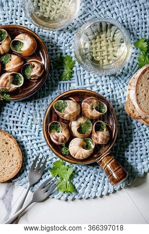 Escargots De Bourgogne - Snails With Herbs Butter, Gourmet Dish, In Traditional Ceramic Pan With Cor
