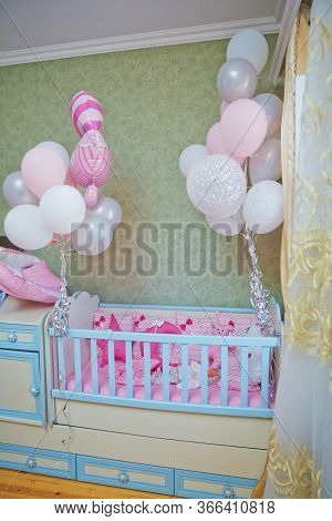 White And Blue Crib . Pink Pillows With Different Patterns Lie In A Children S Blue Tree Crib . Pink