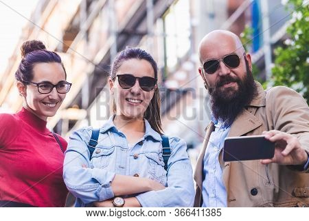 People Taking Picture With Cell Phone.people With Cell Phone On City Street. People Taking Selfie Wi