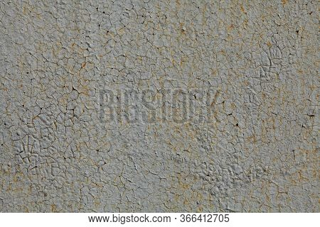 Metallic Wall Background, Texture. An Old Grey And Rusty Surface With Faded Uneven Color. Abstract M