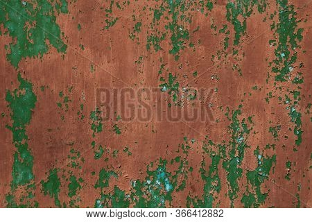 An Old Metallic Wall, Background. Surface, Colored With Red (brown) Faded Color With Peeling Paint A