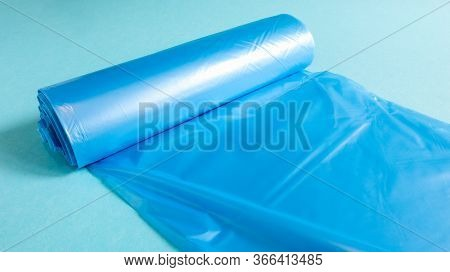 One Roll Of Plastic Garbage Bags In Blue On A Blue Background. Bags That Are Designed To Accommodate