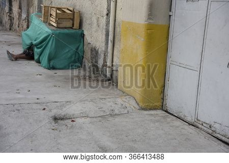 Sao Paulo, Brazil - December 18, 2015: Homeless Man In The Streets Of Sao Paulo. In 2019, The Govern