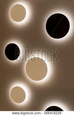 Round Lamps Are Placed On The Wall