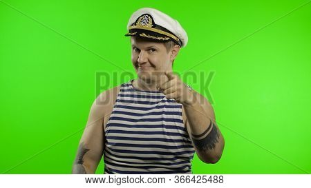 Young Muscular Sailor Man Pointing To Camera With Hands. Seaman Guy Smiling In Sailors Vest. Striped