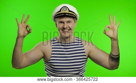 Young Muscular Sailor Man Shows Ok Sign And Looking At Camera. Seaman Guy Smiling In Sailors Vest. S