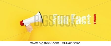 Megaphone In Hand And Inscription Fun Fact On A Yellow Background, Panoramic Image