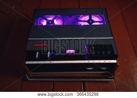 reel to reel audio tape recorder with purple led light strip