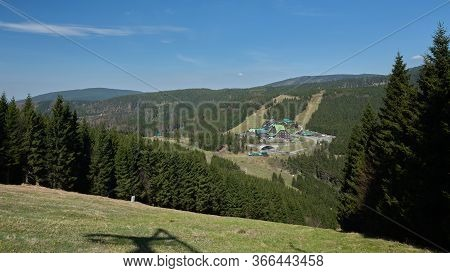 Mountain Huts On A Road At Mountain Pass On A Sunny Cloudless Spring Day. Cervenohorske Sedlo Ski Sl