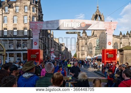EDINBURGH,UK - AUGUST 14,2019 : Tourists and locals participating in the Fringe in Edinburgh - the largest art festival in the world