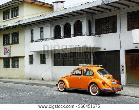 Cuenca, Ecuador - December 22, 2018: Yellow-orange Retro Car Volkswagen Beetle Parked At The City St