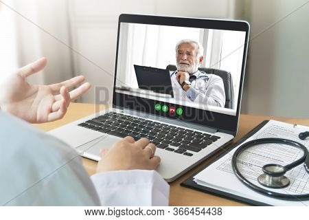 Senior Man Doctor And Physician Team Making Video Call For Discuss, Consult For Pandemic Virus Toget