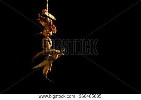 Lemon And Red Chilies Tied With Thread And Tied For Hanging On Doors Isolated On Black Background Wi