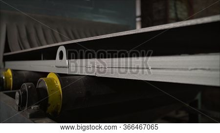 Thick Metal On A Conveyor Belt At An Industrial Plant. Thick Layer Of Steel Sheet On The Conveyor. S