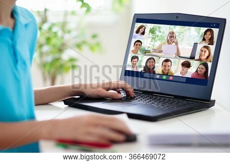 Online Remote Learning. High School Kids With Computer Having Video Conference Chat With Teacher And