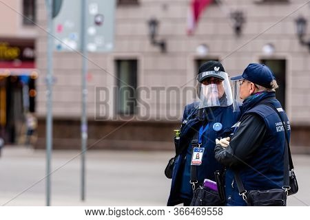 Riga, Latvia - May 14, 2020: Public Transport Ticket Controllers With Face Masks At The Tram Stop, C