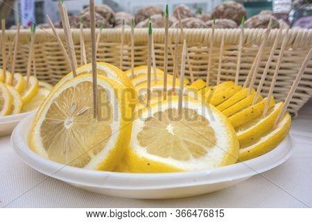 Lemon Decoration. Juicy Yellow Slice Of Lemon Fruit Background. Slices Of Lemon With Sticks Stuck In