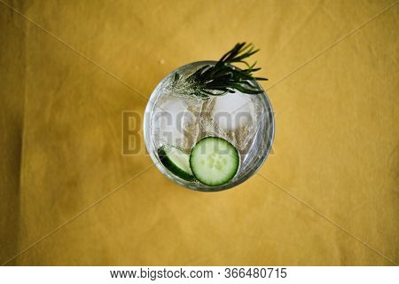 Alcoholic Drink Gin Tonic Cocktail With Cucumber, Rosemary And Ice
