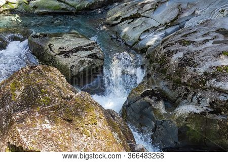 Fiordland National Park. A Stream Disappearing Into A Funnel. Funnel Chasm. Stream Among Stones. New
