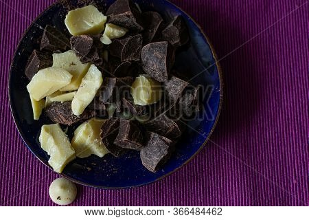 Broken Pieces Of Dark Bitter Chocolate And White Milk Chocolate. Ingredients For Home Cooking Of Hea