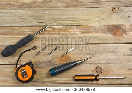 Professional Repairing Implements For Decorating And Building Renovation Set On The Wooden Backgroun