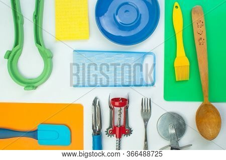 Background Of Kitchen Utensils On White Wooden Kitchen Table. Tools. Top View.