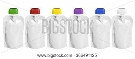 Six White Empty Plastic Doy Pack With Spout And Round Colored Lid Stand In Line, For Baby Food, Frui