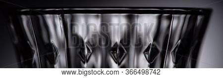 Close Up View Of Empty Faceted Shot Glass On Dark Background, Panoramic Shot