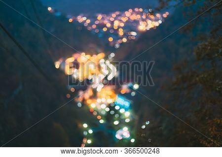 Borjomi, Samtskhe-javakheti, Georgia. Abstract Blurred Bokeh Boke Background Of Evening Borjomi City