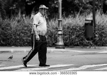 A man walking down the street during the confinement by covid-19 during the state of alarm for the coronavirus crisis in Valencia, Spain on May 15, 2020.