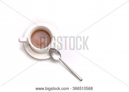 A Cup Of Hot Coffee  With A Silver Tea Spoon Top View On White Isolated Background With Copy Space