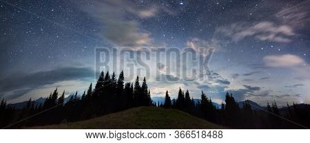 Panoramic View Of A Mountain Hill Facing Spruce Forest And A Mountain Ridge, Magical Starry Night Sk