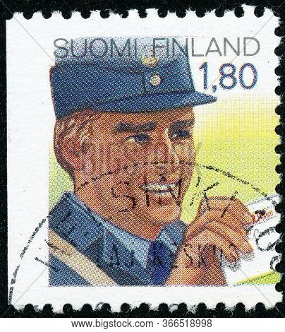 Vintage Stamp Printed In Finland 1988 Show A Postman With A Letter