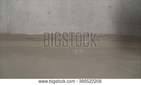 Waterproofing Brush. Waterproofing Coating. Waterproofing A Building With A Brush.