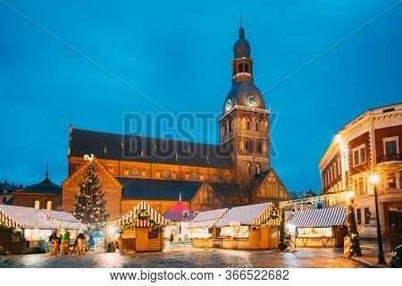 Riga, Latvia - December 13, 2016: Christmas Market On Dome Square With Riga Dome Cathedral. Christma