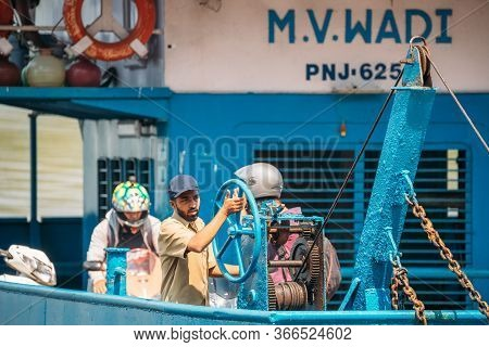 Old Goa, India - February 19, 2020: Man Works On A Ferry. Ferry Across The Mandovi River. Old Goa Fe