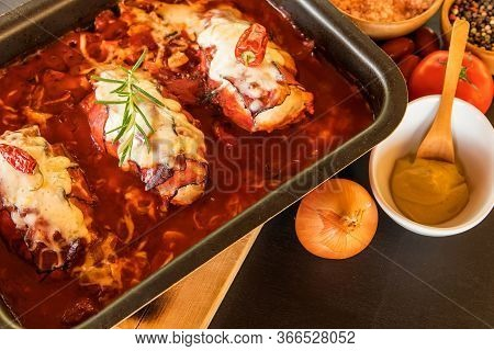 Baked Chicken Breast With Bacon And Cheese In Tomato Sauce. Healthy Food. Home Cooking