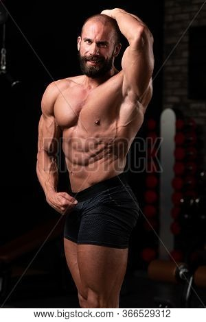 Muscular Bodybuilder Flexing Muscles